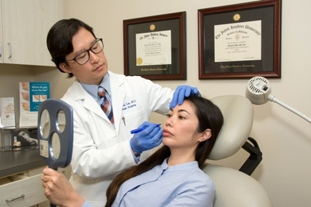 Dr. Lee meeting with patient about facial plastic surgery - Newport Beach, CA